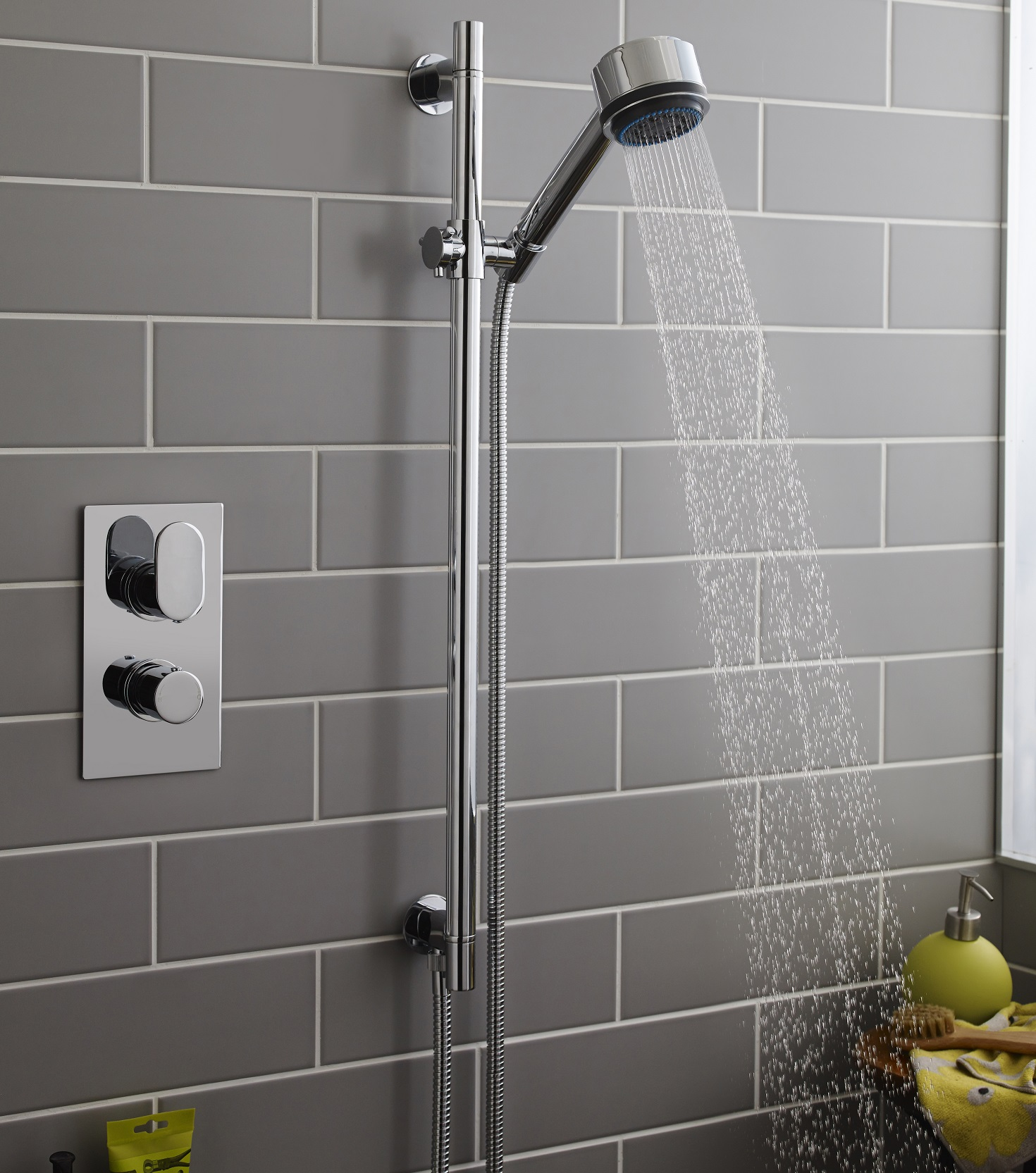 Shower Kit Against A Grey Tiled Wall