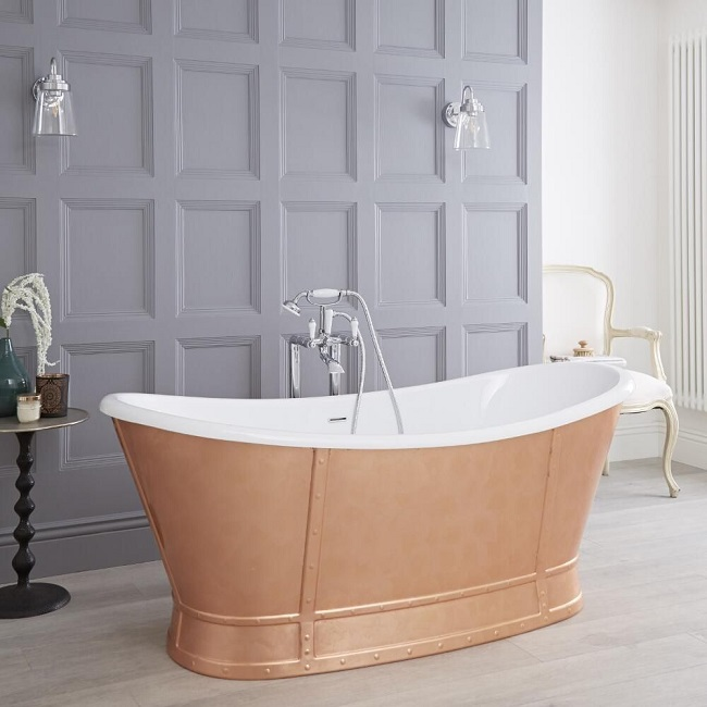 bronze freestanding roll top bath with white interior and freestanding traditional taps
