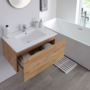 Wood effect wall hung vanity unit with mono tap.