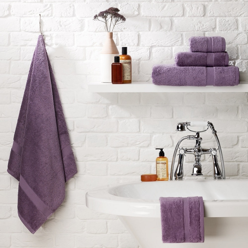 purple towels in white bathroom