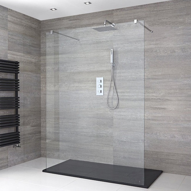 double entry walk in shower with single glass screen and black shower tray