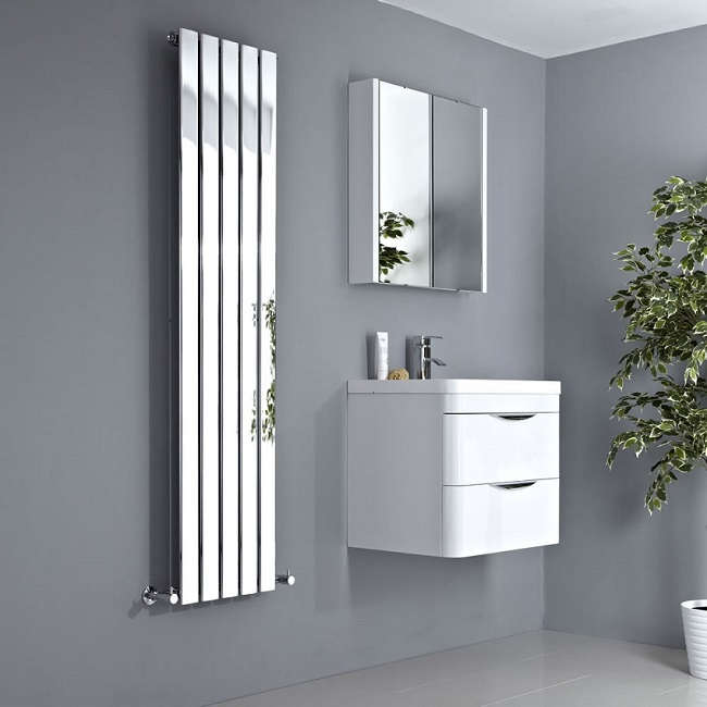 Chrome-vertical-designer-radiator with white wall hung vanity unit and white mirrored wall mounted cabinet