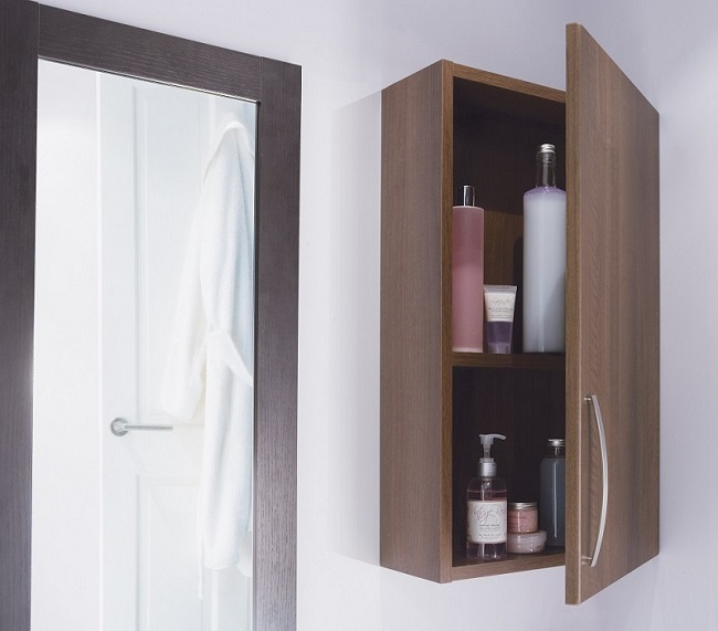 wall hung wooden bathroom cabinet with shelf and toiletries