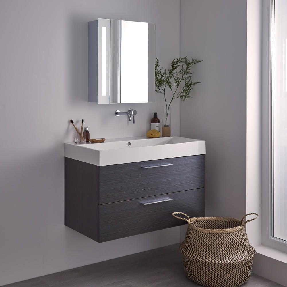 mirrored bathroom cabinet fitted above a vanity unit