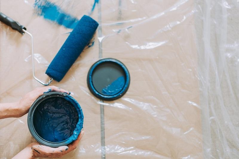 Blue paint pot and paint roller