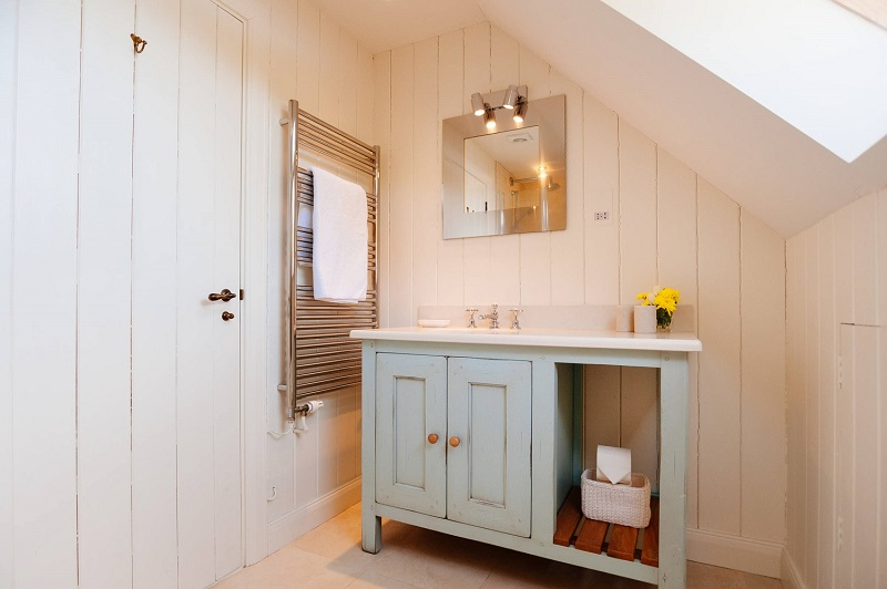 Country style floor standing vanity unit in duck-egg blue with chrome towel rail