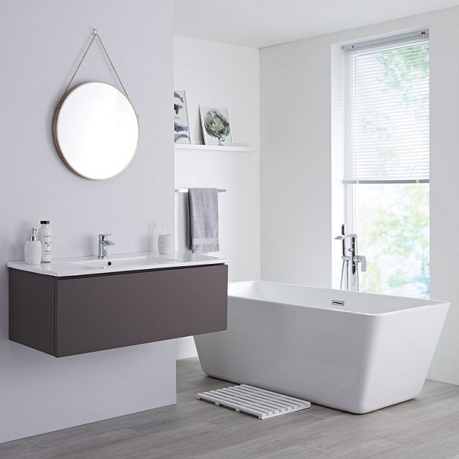 Grey wall hung vanity unit with white freestanding bath