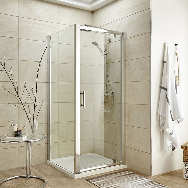Thick framed chrome corner shower cubicle with swivel door