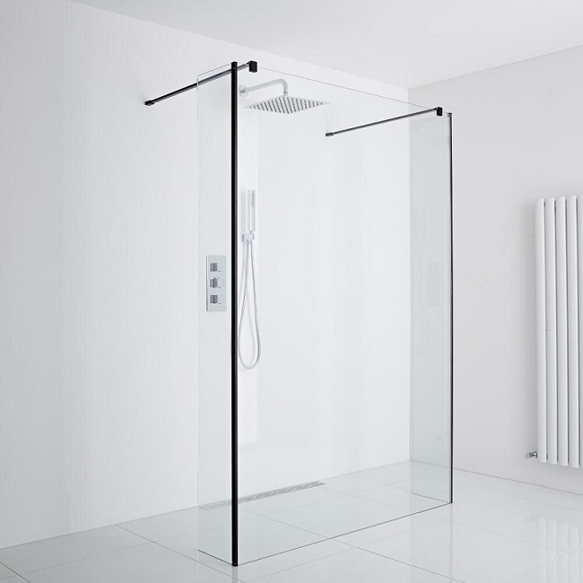walk in shower with black frame in white room
