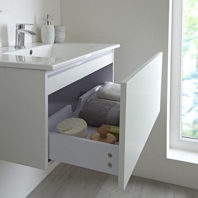 white vanity unit with open drawer