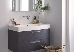 Illuminated bathroom mirror with vanity unit