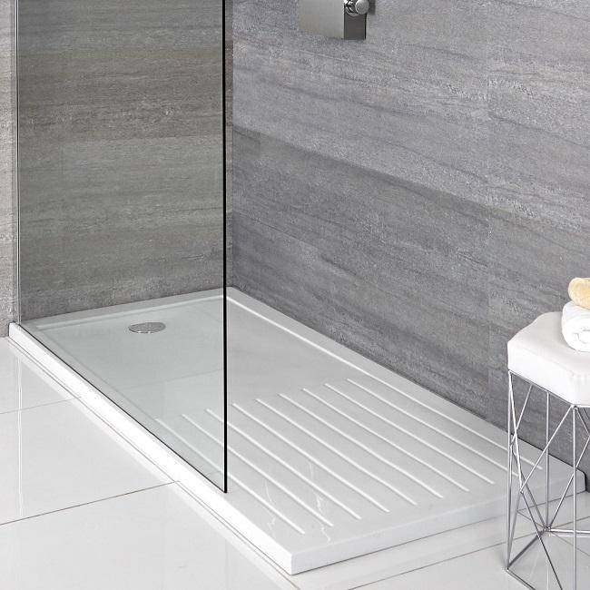 White rectangular walk in shower tray