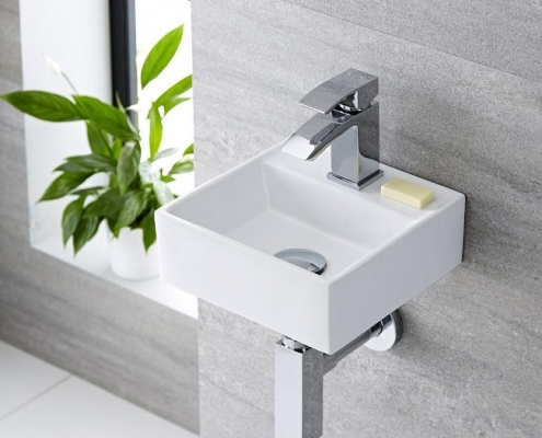 wall hung cloakroom basin with chrome basin tap