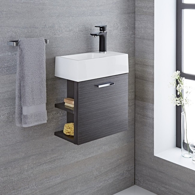 cloakroom vanity unit in a grey finish with open shelves to the left