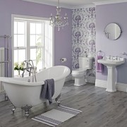 freestanding milano double ended bath in violet room