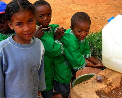 school-kids-in-madagascar-wash-their-hands-with-soap-at-a-portable-hand-washing-station