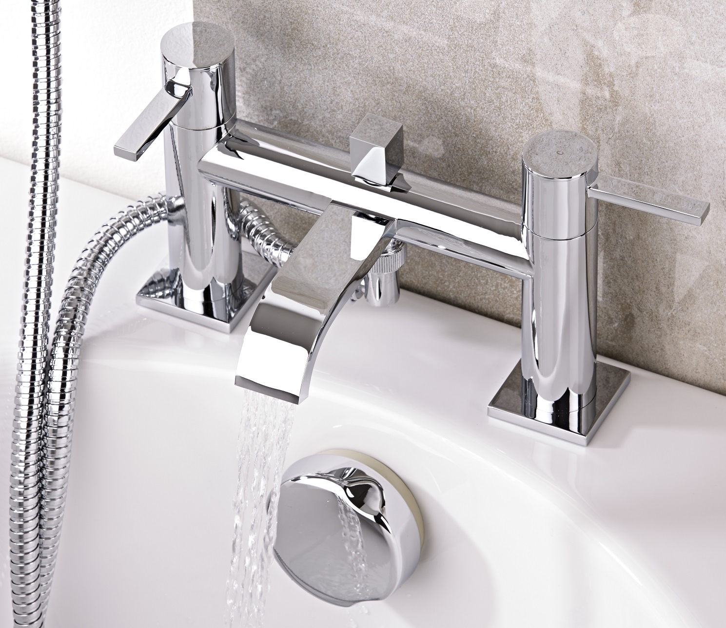 chrome bath tap with water pouring from spout