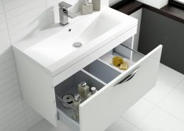 white vanity unit with open drawer in a modern bathroom