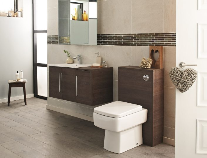 wooden bathroom furniture in modern bathroom with back to wall toilet